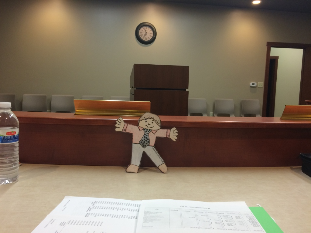Flat Stanley prepares for the meeting.